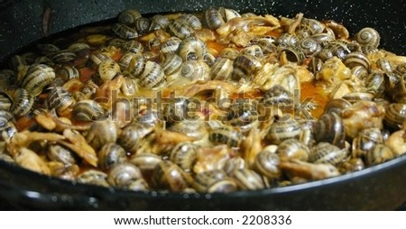 typical spanish dish caracoles (snails), paella style - stock photo