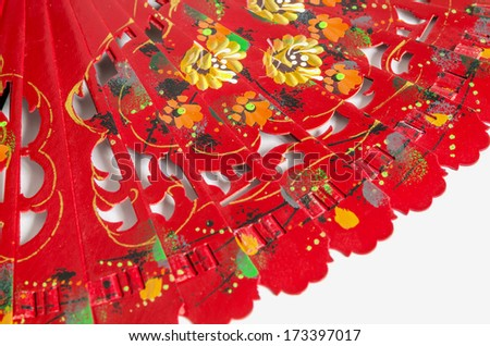 Typical spanish red fan. Detail of the decoration based in flowers - stock photo