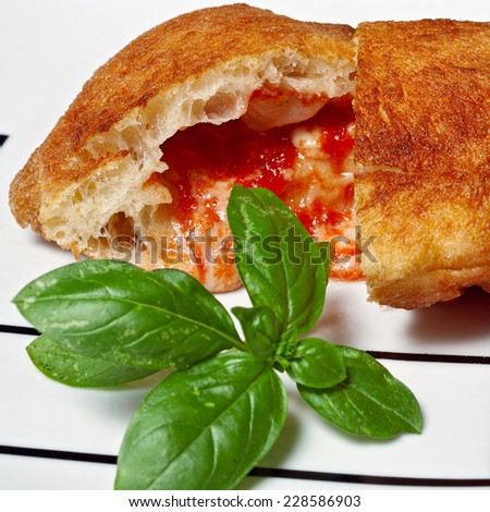 Typical specialty of Puglia, the panzerotto - stock photo