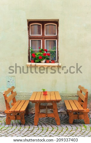 typical street cafe bar, Sighisoara, Romania - stock photo