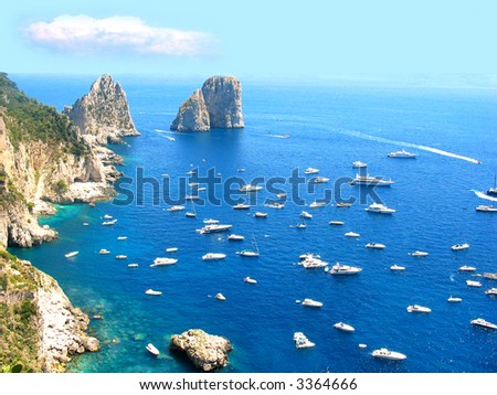 Typical summer day on Capri island, lots of boats and yachts - stock photo