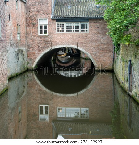 Typical view on old houses in the historic center of Den Bosch, capital of the Noord-Brabant province in the Netherlands, with the river Dieze streaming under the dwellings - stock photo