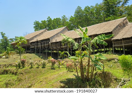 Typical wooden (bamboo) longhouse in Malaysian part of Borneo, Kudat district. - stock photo