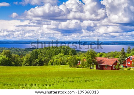 Typical wooden cottage in the countryside, Sweden - stock photo