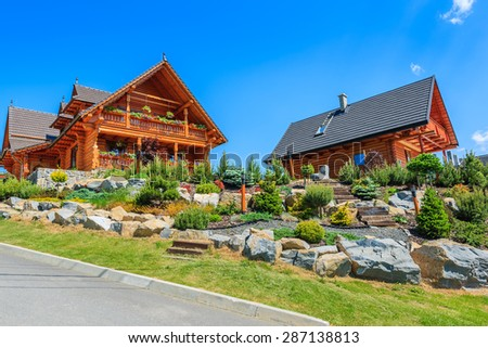 Typical wooden houses in Zdiar village in Tatra Mountains, Slovakia - stock photo
