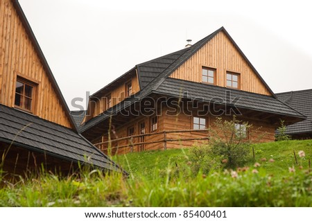 typical wooden houses of Slovak village. Photo taken in Terchova - stock photo