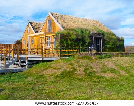 Typical wooden scandinavian house with grass roof, thermoregulation - stock photo