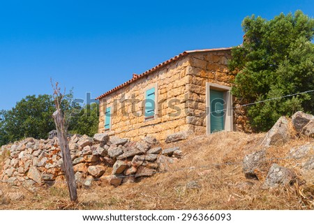 Typically rural landscape of South Corsica, France. Old stone house and trees - stock photo