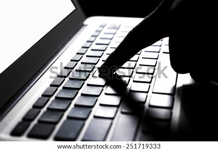 Typing on the keyboard - stock photo