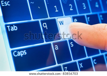 typing www on touch screen virtual keyboard - stock photo