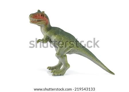 Tyrannosaurus dinosaur plastic figure toy model on white background. - stock photo