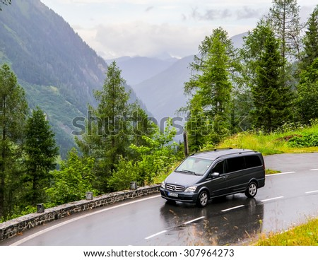 TYROL, AUSTRIA - JULY 29, 2014:  Black luxury van Mercedes-Benz W639 Vito at the Grossglockner High Alpine road. - stock photo