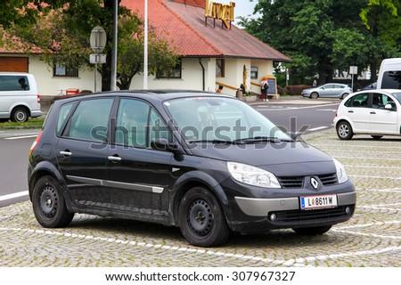 TYROL, AUSTRIA - JULY 28, 2014: Motor car Renault Scenic at the parking near the interurban freeway. - stock photo