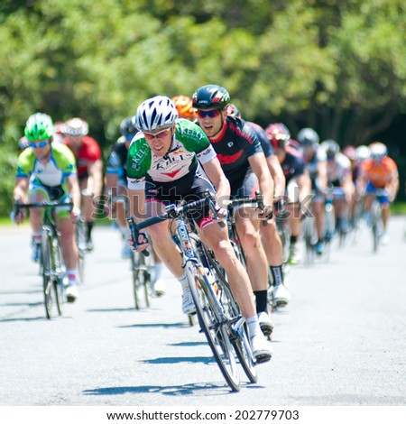 TYSON'S CORNER, VIRGINIA - JUNE 29: Cyclists compete in the elite men's race at the Tour de Tysons on June 29, 2014 in Tyson's Corner, Virginia - stock photo