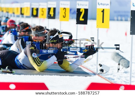 "Tyumen, RUSSIA - APR 9,2014: Martin Fourcade (FRA) and other on firing line at Biathlon  Men's 18 km Mega Mass start at International Biathlon Competition ""Award from the Governor of the Tyumen region - stock photo"