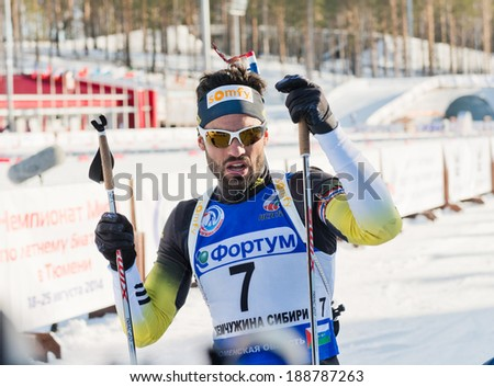 "Tyumen, RUSSIA - APR 9, 2014: Simon Fourcade (FRA) after finish at Biathlon  Men's 18 km Mega Mass start at  International Biathlon Competition ""Award from the Governor of the Tyumen region - stock photo"