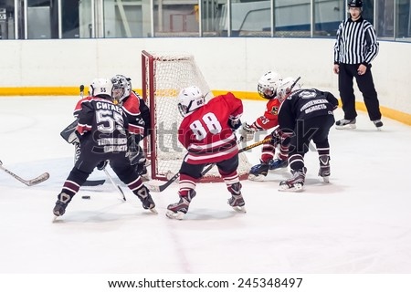 Tyumen, Russia - April 14, 2013: Hockey tournament on prize of name A.P.Vahrin among teams of children till 9 years old. Game between Gazovik 04 (Tyumen) and DYUSSH Metallurg 04 (Novokuznetsk) - stock photo