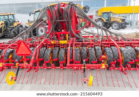 """Tyumen, Russia - April 04. 2014: IV Tyumen specialized exhibition """"Agricultural Machinery and Equipment"""".  Additional equipment for tractor demonstration - stock photo"""