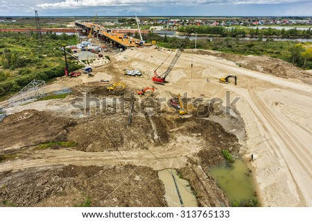 Tyumen, Russia - August 29, 2015: Aerial view of East Round road construction with bridge over Tura river - stock photo