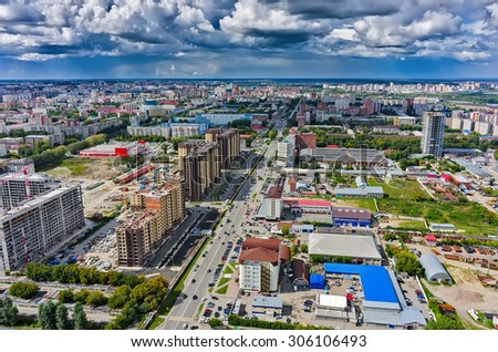 Tyumen, Russia - August 13, 2015: Aerial view onto Magnet hypermarket, Central and Novin residential district construction  and office buildings on Harkovskaya street - stock photo