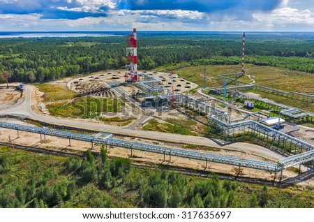 Tyumen, Russia - August 27, 2015: Bird eye view onto torches for burning of associated gas of Antipinsky oil refinery - stock photo