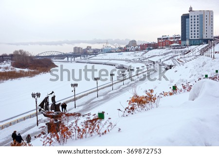 TYUMEN, RUSSIA - JANUARY 6, 2015: People walking at the embankment of river Tura. The first phase of construction of this 4 level embankment was completed in 2012 - stock photo