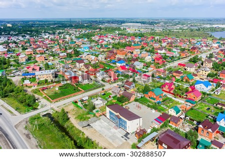 Tyumen, Russia - July 29, 2015: Aerial view onto housing estates in Lesobaza residential district - stock photo