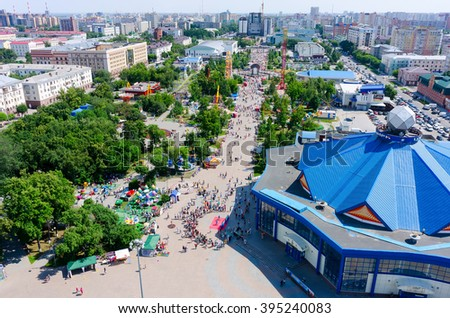 Tyumen, Russia - June 27, 2015: Celebration of Youth Day. People have good time on Colour Boulevard near circus - stock photo