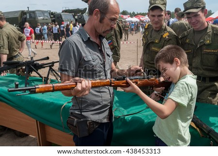 Tyumen, Russia - June 11, 2016: Race of Heroes project on the ground of the highest military and engineering school. Exhibition of weapon. Boy aims in Mosin's rifle - stock photo