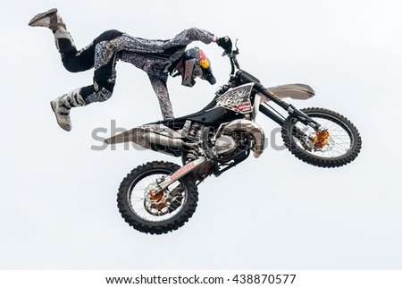 Tyumen, Russia - June 10, 2009: Red Bull X-Fighters Exhibition Tour. Freestyle Motocross. Sportsman carries out a trick - stock photo