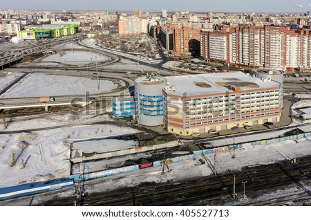 Tyumen, Russia - March 11, 2016: Office building near railways and roads intersection - stock photo