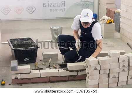 Tyumen, Russia - March 23. 2016: Open championship of professional skill among youth. World skills Russia Tyumen - 2016. Young bricklayer performs a task of competition of professionals - stock photo