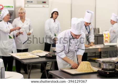 Tyumen, Russia - March 23, 2016: Open championship of professional skill among youth. World skills Russia Tyumen - 2016. Cooks prepare food in competition of masters of cook business - stock photo