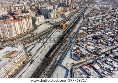 Tyumen, Russia - March 11, 2016: The railroad along 50 let VLKSM Street, dividing old and new districts of the city - stock photo