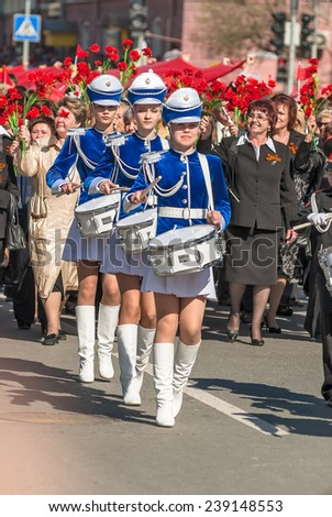 Tyumen, Russia - May 9. 2009: Parade of Victory Day in Tyumen. Drummer girls drum - stock photo
