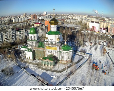 Tyumen, Russia - November 9, 2014: Aerial view on temple chapel in honor of the Lady Day - stock photo