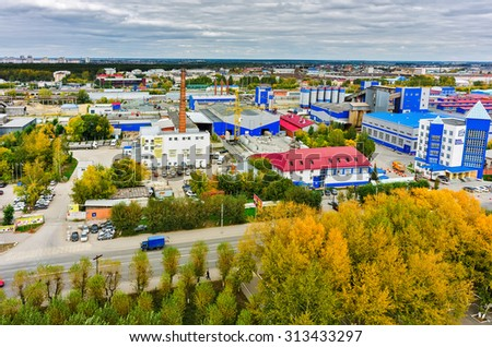 Tyumen, Russia - September 4, 2015: Aerial view onto factory of Tyumen House-building Company and other industrial firms - stock photo
