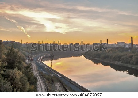 Tyumen, Russia - September 25, 2005: Construction equipment on building construction of pedestrian quay and pesestrian Lovers Bridge on Tura river - stock photo
