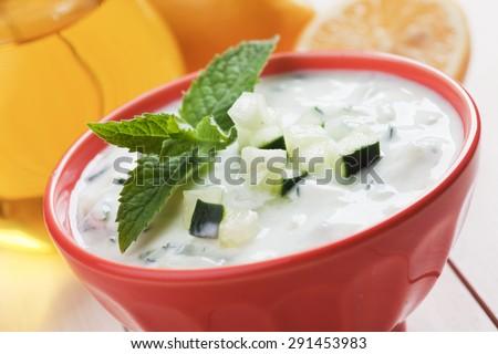 Tzatziki or cacik, cucumber, yogurt and lemon salad with fresh mint - stock photo