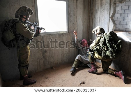 TZEELIM,ISR  - March 31 2011: Israeli infantry soldiers are participating in an exercise of integrated urban warfare that simulates fighting a war in Gaza. - stock photo