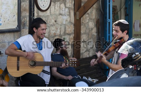 TZFAT (SAFED), ISRAEL - OCTOBER 24, 2014: Unidentified musicians perform in Pre Shabbat celebration on one of the streets. Tzfat (Safed) is spiritual and artistic centre of Israel. - stock photo