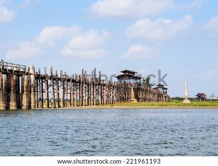 U-Bein bridge in Mandalay , Myanmar. This bridge is believed to be the oldest and longest teak wood bridge in the world with 1.2-kilometre length. - stock photo
