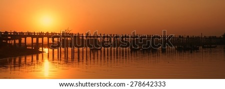 U Bein Bridge over Irrawaddy near Mandalay Myanmar at sunset - stock photo