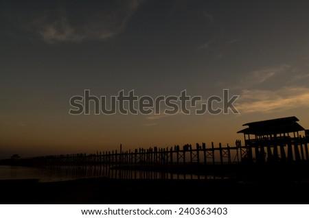 U Bien Bridge sunset, Amarapura, Myanmar - stock photo