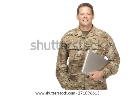 U.S. Army Soldier, Sergeant. Isolated and holding laptop with smile on face. - stock photo