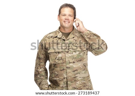 U.S. Army Soldier, Sergeant. Isolated and smiling with a cell phone in hand. - stock photo
