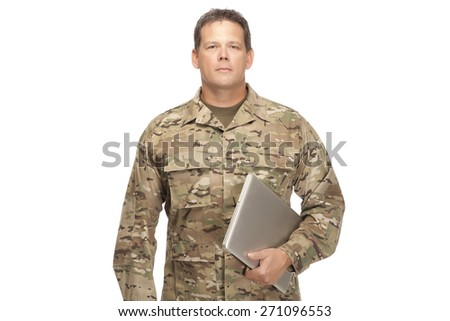 U.S. Army Soldier, Sergeant. Isolated while holding computer laptop with serious look on face. - stock photo