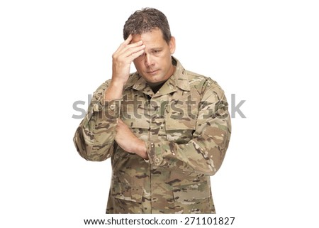 U.S. Army Soldier, Sergeant. Isolated with hands on head showing stress or sadness. - stock photo