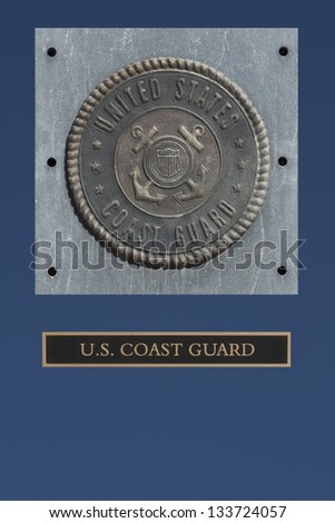U.S. Coast Guard emblem on granite with blue background - stock photo
