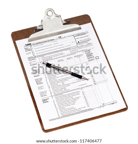 U.S. 2012 income tax form 1040 on a clipboard with a pen. Isolated on white with a clipping path. - stock photo